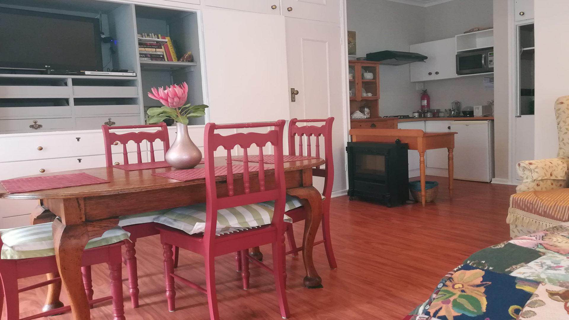 Eastbury Cottage rose room dining and kitchenette
