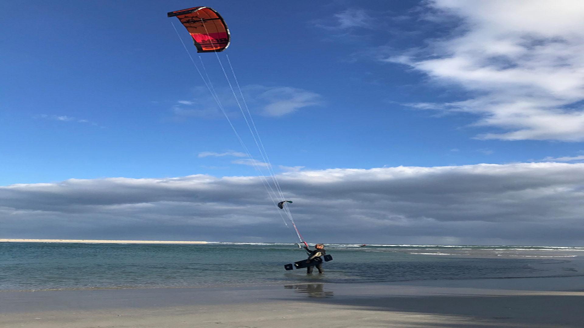 kite-surf-hermanus-surfer-standing-768x1024